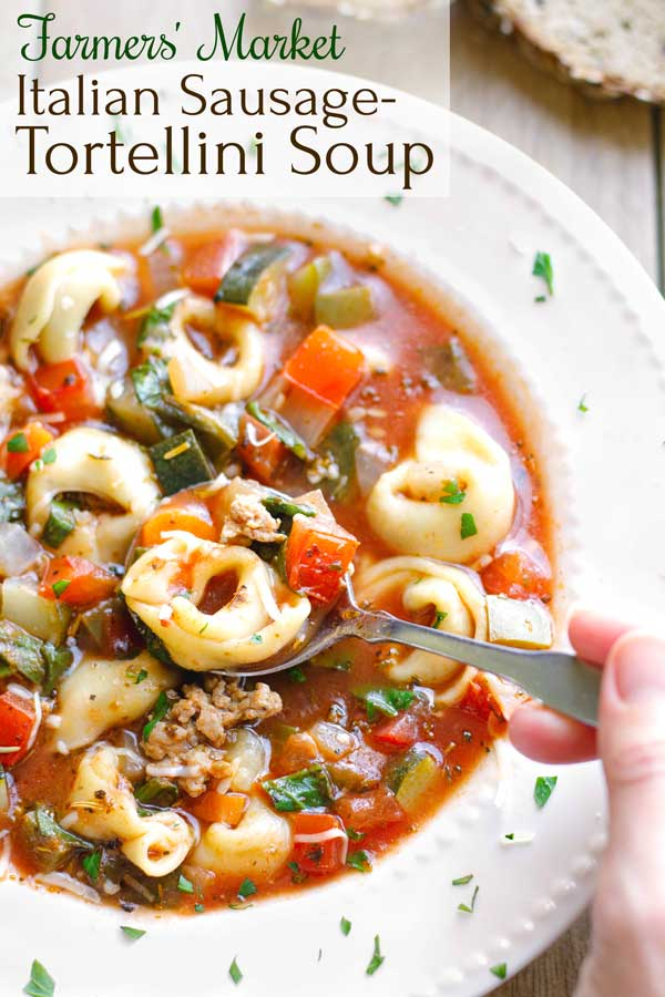 Absolutely delicious – a beloved family favorite! This Farmers' Market Italian Sausage-Tortellini Soup recipe is richly flavorful and so satisfying! It's loaded with savory sausage, pillowy tortellini, and lots of vibrant, fresh veggies! Great for using up summer vegetables ... but easy to make in winter with grocery store veggies, too! Try this quick, easy soup recipe all year 'round! | tortellini recipes | soup recipes | soup recipes healthy | vegetable soup | www.TwoHealthyKitchens.com