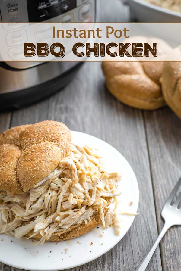 Reader favorite recipe – try it and you'll see why! Tender shredded chicken is accented with a bold, savory sauce, piled high on pillowy, soft buns! These crazy-delicious, super-EASY Carolina-Style Instant Pot BBQ Chicken Sandwiches need only 5 ingredients and 5 minutes of prep! So simple in your electric pressure cooker! | shredded chicken instant pot | instant pot chicken recipes | pressure cooker recipes | pressure cooker chicken | chicken recipes | Carolina bbq sauce | www.TwoHealthyKitchens.com