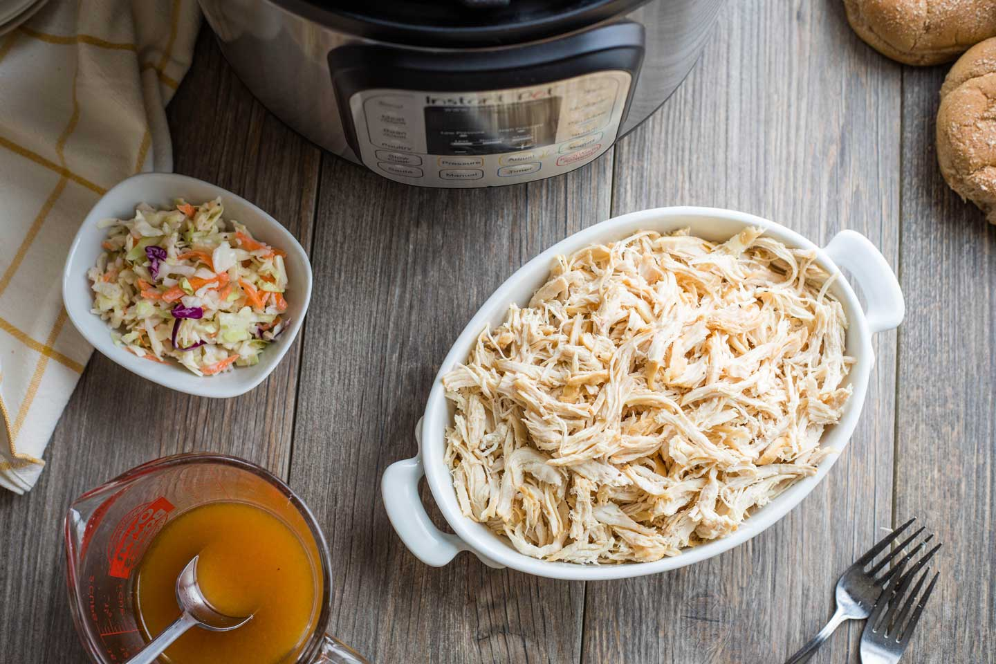 overhead photos of Instant Pot, shredded chicken, BBQ sauce, coleslaw, and buns - ready to make sandwiches