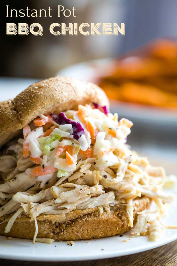 Insanely delicious, super EASY Carolina-Style Instant Pot Shredded BBQ Chicken Sandwiches! This pressure cooker chicken recipe uses just 5 common ingredients, and takes only 5 minutes to prep! Tender pulled chicken accented with a bold, savory sauce, piled high on soft buns! A true reader favorite – try it and you'll see why! | Instant pot recipes easy | instant pot chicken recipes | pressure cooker recipes | shredded chicken recipes | shredded chicken instant pot | www.TwoHealthyKitchens.com