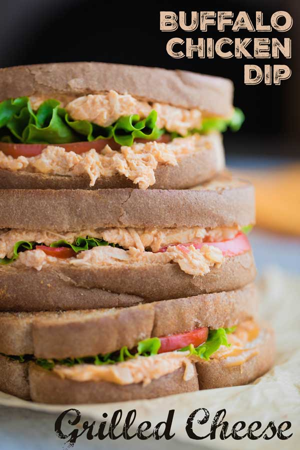 sideways shot of a stack of 3 finished sandwiches
