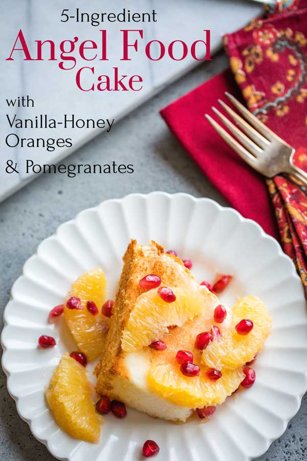 "pinnable image of this dessert with the text overlay ""5-Ingredient Angel Food Cake with Vanilla-Honey Oranges & Pomegranates"""