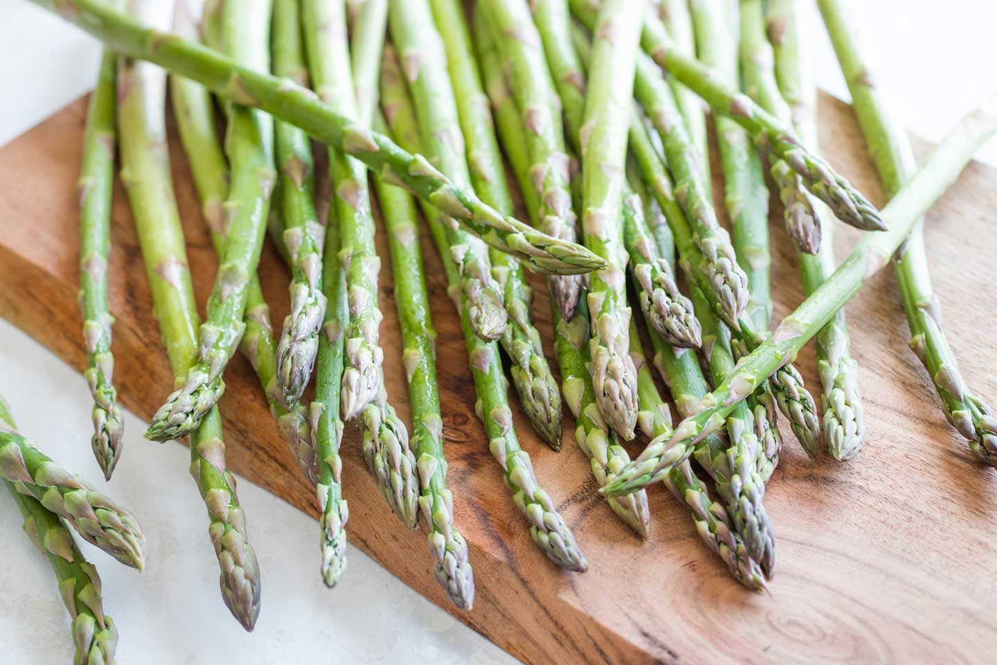 Overhead closeup of really fresh asparagus spears damp with water droplets.
