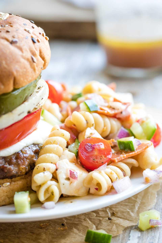 Closeup of this salad served next to an Italian hamburger.